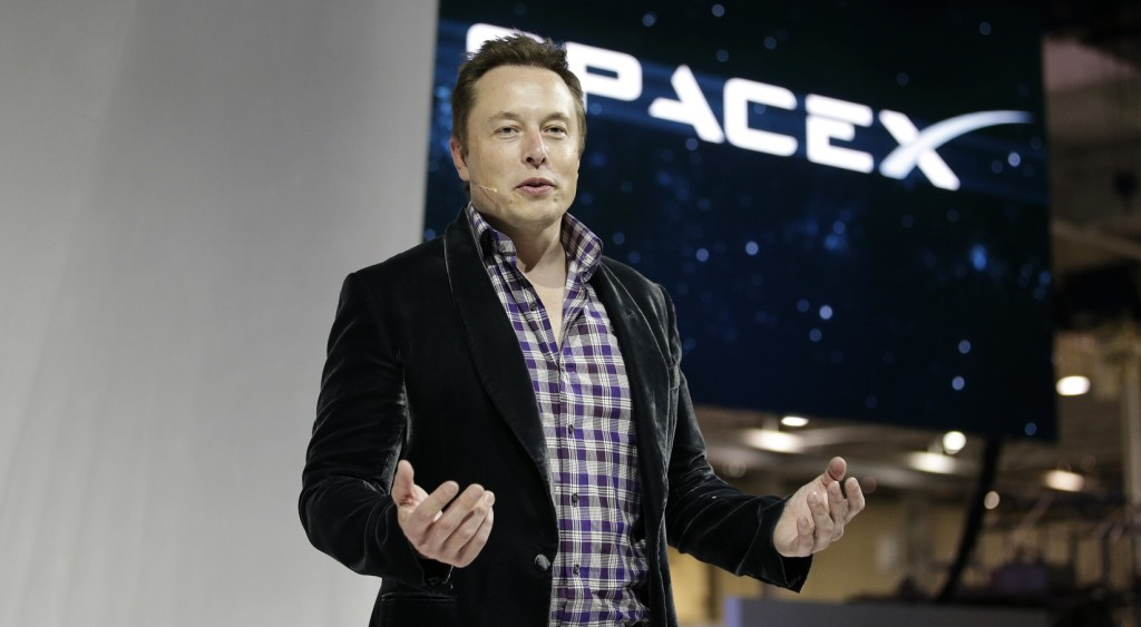 FILE- In this May 29, 2014 file photo, Elon Musk, CEO and CTO of SpaceX, introduces the SpaceX Dragon V2 spaceship at the SpaceX headquarters in Hawthorne, Calif. SpaceX said it has raised $1 billion and added Google Inc. and Fidelity as investors. (AP Photo/Jae C. Hong, File)